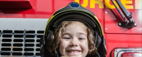 child dressed up as a firefighter